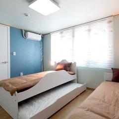 Отель Triangel Guesthouse Южная Корея, Сеул - отзывы, цены и фото номеров - забронировать отель Triangel Guesthouse онлайн комната для гостей фото 4