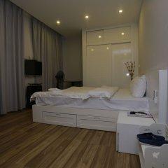 Отель Suji Home Ханой сейф в номере