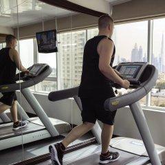 Отель Jumeira Rotana фитнесс-зал