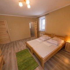 Отель Pokoje i Apartamenty Nad Potokiem Закопане комната для гостей фото 2