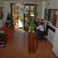 Отель Agritur Le Pergole Помароло интерьер отеля фото 2
