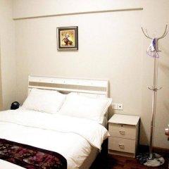 Апартаменты Shenzhen Haicheng Apartment комната для гостей фото 5