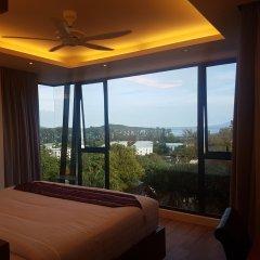 Отель At The Tree Condominium Phuket Стандартный номер с различными типами кроватей