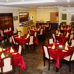 Отель Grand Inn & Suites