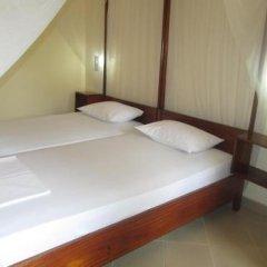 Отель Tandem Guest House Хиккадува сейф в номере