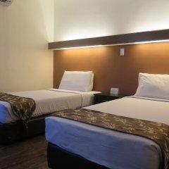 Отель The Ritz Hotel at Garden Oases Филиппины, Давао - отзывы, цены и фото номеров - забронировать отель The Ritz Hotel at Garden Oases онлайн комната для гостей фото 3