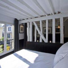 Отель Les Suites Parisiennes Франция, Париж - отзывы, цены и фото номеров - забронировать отель Les Suites Parisiennes онлайн балкон