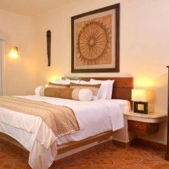 Отель Porto Playa Condo Hotel & Beachclub Мексика, Плая-дель-Кармен - отзывы, цены и фото номеров - забронировать отель Porto Playa Condo Hotel & Beachclub онлайн комната для гостей фото 3