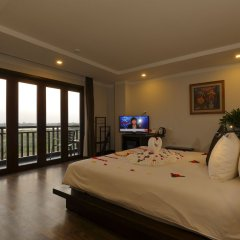 Отель Hoi An Odyssey Hotel Вьетнам, Хойан - 1 отзыв об отеле, цены и фото номеров - забронировать отель Hoi An Odyssey Hotel онлайн комната для гостей фото 4