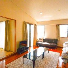 Отель Resort Mansion SeaZone Центр Окинавы комната для гостей фото 3
