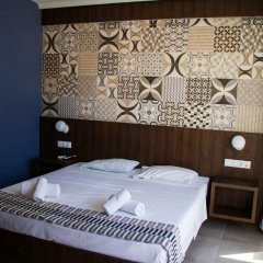 Отель Stalis Blue Sea Front Deluxe Rooms комната для гостей