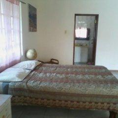 Отель Dolphin Bay Yoga Guest House Ямайка, Порт Антонио - отзывы, цены и фото номеров - забронировать отель Dolphin Bay Yoga Guest House онлайн комната для гостей фото 4