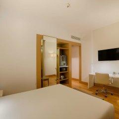 Отель NH Milano Touring удобства в номере фото 2