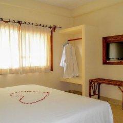 Отель Bungalows La Madera Мексика, Сиуатанехо - отзывы, цены и фото номеров - забронировать отель Bungalows La Madera онлайн комната для гостей фото 2