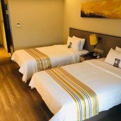 Отель Home Inn Plus (Xi'an South Second Ring 4th Gaoxin Road) Китай, Сиань - отзывы, цены и фото номеров - забронировать отель Home Inn Plus (Xi'an South Second Ring 4th Gaoxin Road) онлайн комната для гостей фото 2