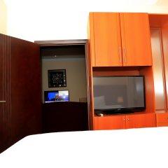 Отель Swiss International Mabisel Port Harcourt Нигерия, Порт-Харкорт - отзывы, цены и фото номеров - забронировать отель Swiss International Mabisel Port Harcourt онлайн удобства в номере фото 2