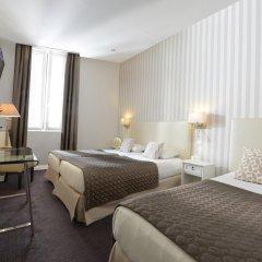 Отель Hôtel Des Batignolles Франция, Париж - 10 отзывов об отеле, цены и фото номеров - забронировать отель Hôtel Des Batignolles онлайн комната для гостей фото 2