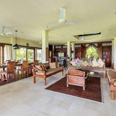 Отель Beachfront Citakara Sari Villas Индонезия, Бали - отзывы, цены и фото номеров - забронировать отель Beachfront Citakara Sari Villas онлайн интерьер отеля