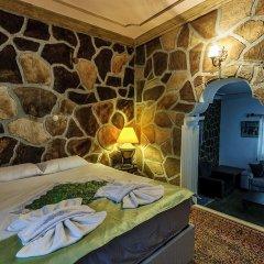 Отель Kapor Organik çiftlik evi Аванос комната для гостей