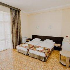 Гостиница Мандарин комната для гостей фото 9