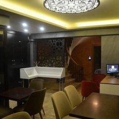 Отель Terra Suites сейф в номере