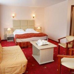 Амакс Визит Отель комната для гостей