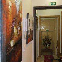 Отель Alojamento Cesarini Португалия, Монтижу - отзывы, цены и фото номеров - забронировать отель Alojamento Cesarini онлайн интерьер отеля