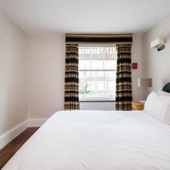 Апартаменты Tavistock Place Apartments Лондон комната для гостей фото 4