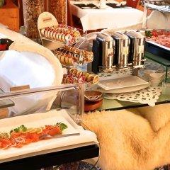 Отель Unique Hotel Eden Superior Швейцария, Санкт-Мориц - отзывы, цены и фото номеров - забронировать отель Unique Hotel Eden Superior онлайн питание