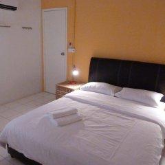 Отель Orange Pekoe Guesthouse Малайзия, Куала-Лумпур - отзывы, цены и фото номеров - забронировать отель Orange Pekoe Guesthouse онлайн комната для гостей фото 2