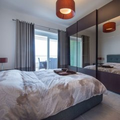 Отель Seafront Luxury Apartment With Pool Мальта, Слима - отзывы, цены и фото номеров - забронировать отель Seafront Luxury Apartment With Pool онлайн комната для гостей