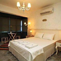 Отель Mina Otel Alacati Чешме комната для гостей фото 2