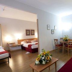 Отель Aparto Suites Muralto комната для гостей фото 3