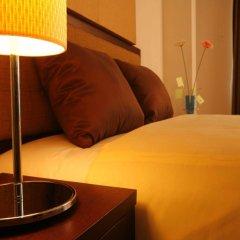 Апартаменты Romance Serviced Apartment Бангкок в номере