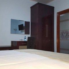 Отель White City Inn Габороне сейф в номере