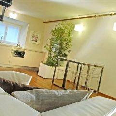 Отель Terres d'Aventure Suites Италия, Турин - отзывы, цены и фото номеров - забронировать отель Terres d'Aventure Suites онлайн комната для гостей фото 5