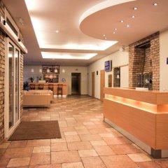 Отель Toss Hotel Латвия, Рига - 11 отзывов об отеле, цены и фото номеров - забронировать отель Toss Hotel онлайн интерьер отеля фото 2