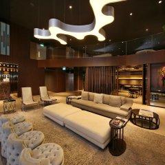 Отель Pan Pacific Serviced Suites Beach Road, Singapore интерьер отеля