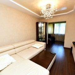 Апартаменты Inzhir Na Vorovskogo 20 Apartments Сочи комната для гостей фото 3