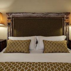 Отель The Xara Palace Relais & Chateaux сейф в номере