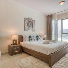 Отель Premium Apt - Full Burj Khalifa & Fountain View! Дубай комната для гостей фото 2