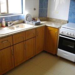 Апартаменты Calabash Green Executive Apartments Тема в номере фото 2