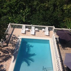 Отель Retreat Guest House Ямайка, Дискавери-Бей - отзывы, цены и фото номеров - забронировать отель Retreat Guest House онлайн бассейн фото 3