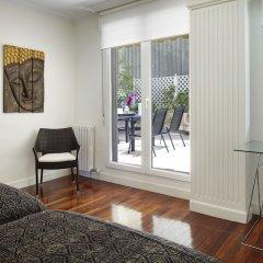 Апартаменты Playa de La Concha 3 Apartment by FeelFree Rentals комната для гостей