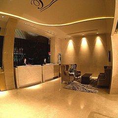 Отель Shenzhen Tourism Trend Hotel Китай, Шэньчжэнь - отзывы, цены и фото номеров - забронировать отель Shenzhen Tourism Trend Hotel онлайн интерьер отеля