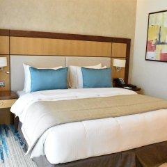 Отель Golden Tulip Al Thanyah комната для гостей фото 5