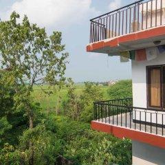 Отель Lumbini Village Lodge Непал, Лумбини - отзывы, цены и фото номеров - забронировать отель Lumbini Village Lodge онлайн балкон
