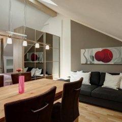 Апартаменты Paleo Finest Serviced Apartments Мюнхен комната для гостей