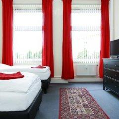 Отель Berliner City Pension Uhlandstrasse Берлин комната для гостей фото 3