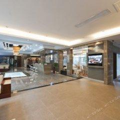 Отель Freedon Waterscape Resort Hotel Китай, Сямынь - отзывы, цены и фото номеров - забронировать отель Freedon Waterscape Resort Hotel онлайн интерьер отеля